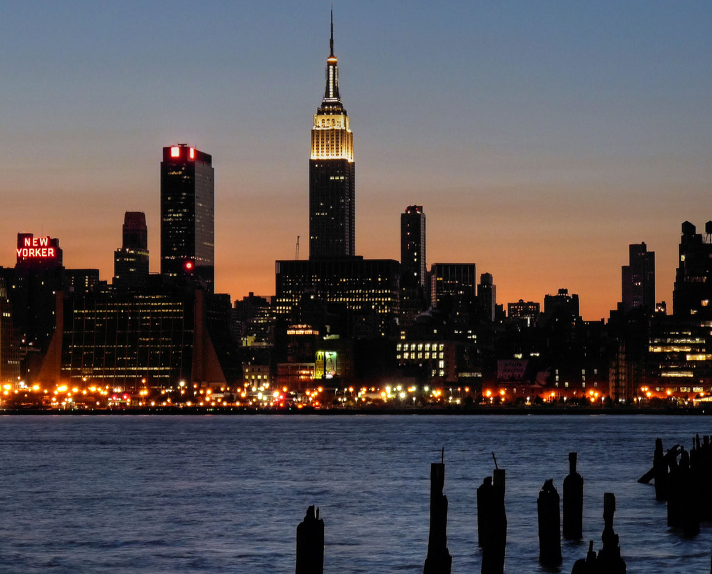 Night shot of the Empire state building taken from across the bay