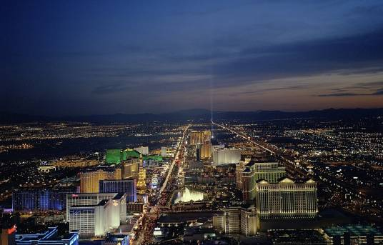 Night shot of the Las Vegas Strip with casinos lit up.