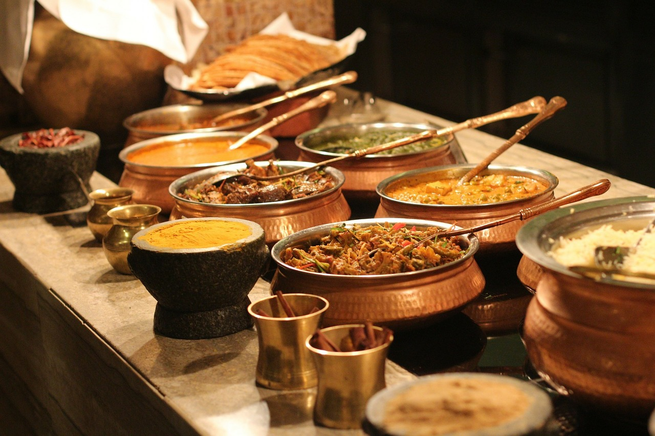 Indian food serverd in copper bowls