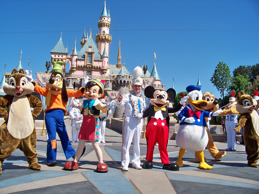 Main Disney characters performing in front of the castle in Disneyland